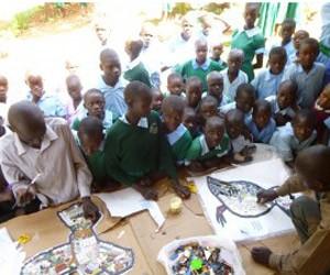 Oogo school children creating their mosaics