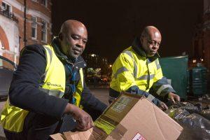 Environmental enforcement Officers examining dumped rubbish