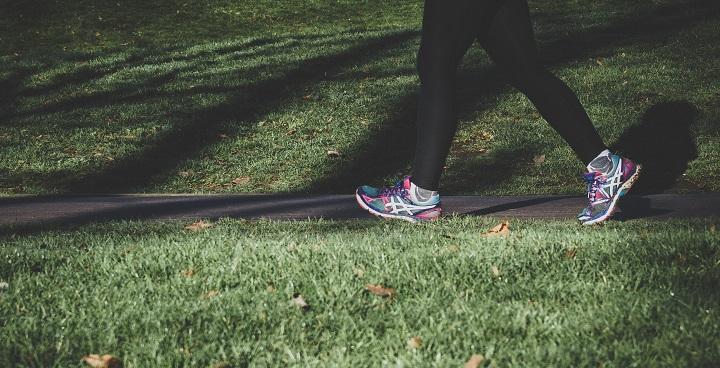 female walking through park