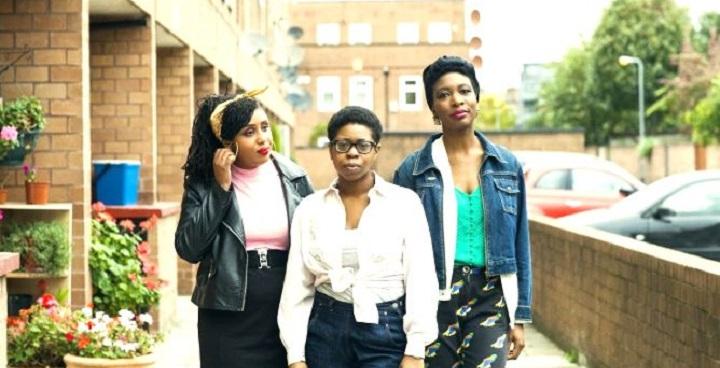 Three black girls pose for photo