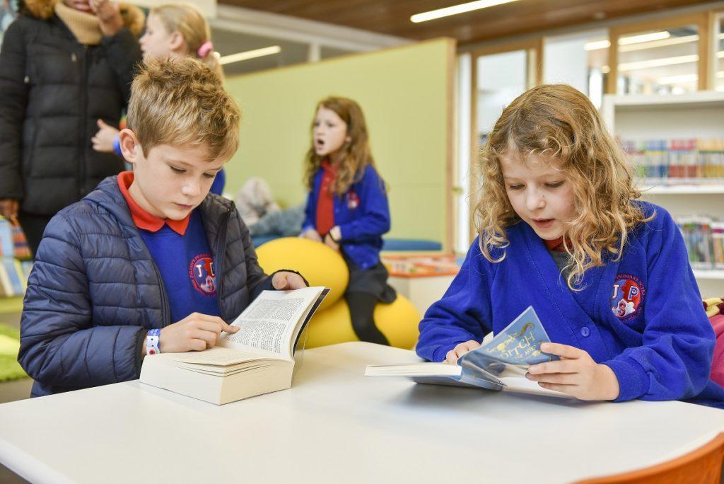 Children from Julian's Primary School reading