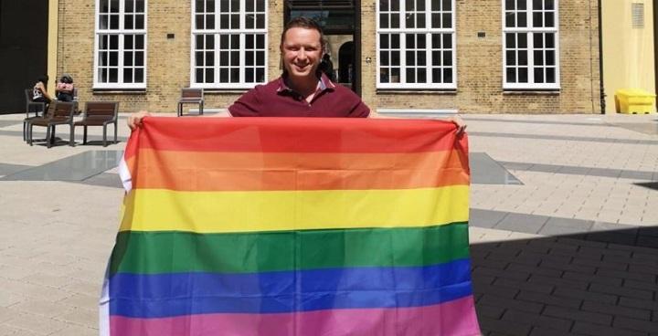 Cllr Paul Gadsby with Pride flag