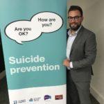 Mental Health campaigner Jonny Benjamin with Lambeth 'Time to Change' mental health campaign banner