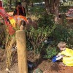 child in blue gloves and adult in orange hi-viz at Vauxhall Park at community planting day