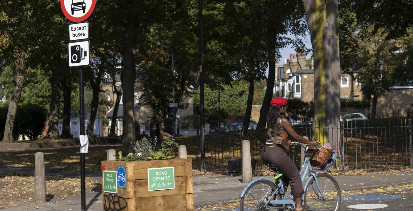 A woman cycles through the Railton Low Traffic Neighbourhood in Brixton