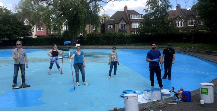 volunteers painting Streatham Common paddling pool